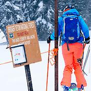 Jess McMillan exits the boundary of Jackson Hole Mountain Resort on a powder day.