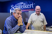 02 JUNE 2012 - PHOENIX, AZ:  Congressman DAVID SCHWEIKERT (R-AZ) listens to campaign volunteers Saturday. Schweikert met with his campaign staff and volunteers for a pancake breakfast Saturday morning at the campaign headquarters to talk to them about the upcoming primary election against fellow Republican Ben Quayle. Republican incumbents Schweikert and Quayle will face each other in Arizona's Aug. 28 primary election. Redistricting because of the census has thrown the two conservative freshman Republican Congressmen into Arizona's 6th Congressional District. The district is made up of mostly upper middle class neighborhoods in north Phoenix and the wealthy suburban communities of Scottsdale, Fountain Hills and Cave Creek. The District is strongly Republican and whoever wins the Republican primary is expected to easily win November's general election.        PHOTO BY JACK KURTZ