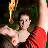 Picture shows :  Writer Ailsa Longmuir  (in black) learns the Art of Fire Breathing / Fire Eating with her first  lesson from the Purple Productions team of Rufus T. Fahrenheit (pictured) and Lucille Burn (animal print)....Picture Drew Farrell Tel : 07721-735041.