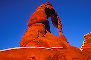 Warm evening light on Delicate Arch in winter, Arches National Park, Utah USA