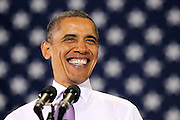 Oct 29, 2010. President Barack Obama smiles at the crowd during the campaign rally for Virginia 5th District Representative Congressman Tom Perriello Friday at the Charlottesville Pavilion in downtown Charlottesville, Va. Photo/Andrew Shurtleff