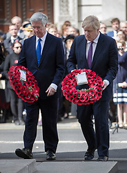 © Licensed to London News Pictures. 25/04/2017. London, UK. Defence Sectretary Michael Fallon (L) and British Foreign Secretary Boris Johnson lay wreaths during the ANZAC Day ceremony at the Cenotaph in Whitehall. A dawn ceremony and service was held at The Australian War Memorial and The New Zealand War Memorial at Hyde Park Corner.  April 25th is the day that Australia and New Zealand remember the dead of all wars. Photo credit: Peter Macdiarmid/LNP