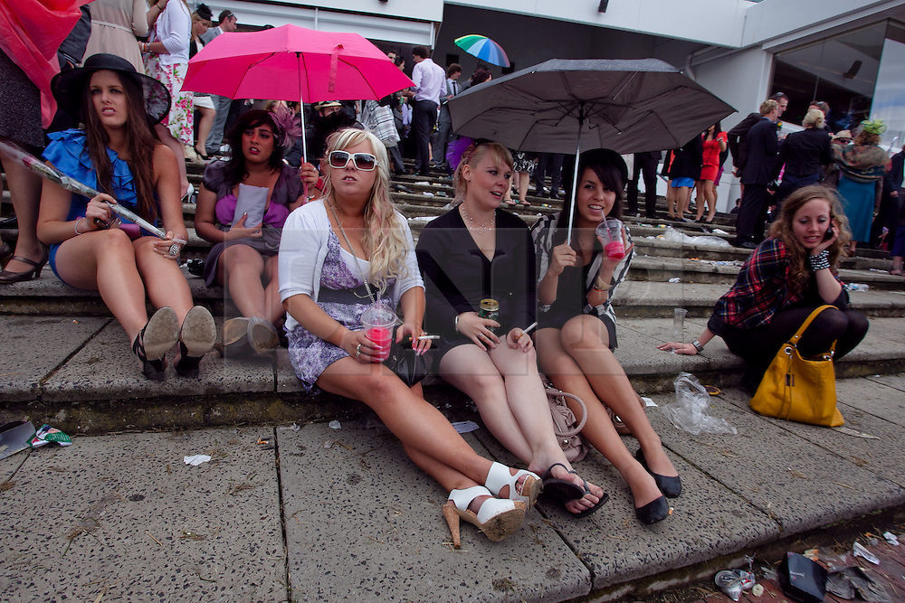 (c) under License to London News Pictures 02/11/2010. Young racegoers resting after a big day at the 2010 Melbourne cup