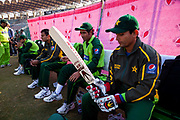 Pakistan National Cricket team inside Gaddafi Stadium, Lahore during a week long training camp period prior to the 2011 ICC World Cricket Cup. Seen here dressing and putting on protective gloves and pads.