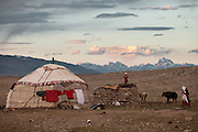 View of the summer camp of Muqur, Er Ali Boi's place. The mountains in the distance are in China...Trekking through the high altitude plateau of the Little Pamir mountains (average 4200 meters) , where the Afghan Kyrgyz community live all year, on the borders of China, Tajikistan and Pakistan.