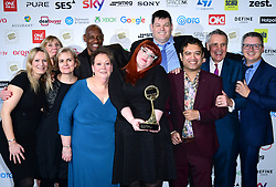 Anne Hegerty, Shaun Wallce, Jenny Ryan, Makr Labbett, and Paul Sinha and the crew of The Chase with the award for Best Daytime Programme at the TRIC Awards 2019 50th Birthday Celebration held at the Grosvenor House Hotel, London.