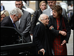 Rolf Harris arrives at Southwark Crown Court, London, United Kingdom, with his wife Alwen Hughes  (right glasses) he is expected to give evidence in his trial today. Tuesday, 27th May 2014. Picture by Andrew Parsons / i-Images