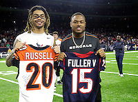 Houston Texans wide receiver Will Fuller, left, and Cincinnati Bengals cornerback KeiVarae Russell exchange jerseys after an NFL football game Saturday, Dec. 24, 2016, in Houston. The Texans won 12-10. (AP Photo/Sam Craft)