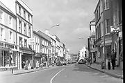 Main Street Killarney in the 1980's.<br /> Photo: macmonagle.com archive<br /> <br /> Killarney Now & Then - MacMONAGLE photo archives.<br /> Facebook - @killarneynowandthen