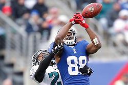 New York Giants wide receiver Hakeem Nicks #88 attempts to catch a pass with Philadelphia Eagles cornerback Dimitri Patterson #23 defending during the NFL Game between the Philadelphia Eagles and the New York Giants. The pass was incomplete and the Eagles won 38-31 at The New Meadowlands Stadium in East Rutherford, New Jersey on Sunday December 19th 2010. (Photo By Brian Garfinkel)