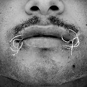 """Los Anegados<br /> <br /> Se hacen llamar a si mismos """"Los Anegados"""", son prisioneros que cosen su boca para pedir traslado de prisión  ya que su vida está en peligro en su actual centro penitenciario. Cosen su boca como parte de una huelga de hambre.<br /> <br /> El acto desesperado también es llevado a cabo como un medio de protección en contra de las bandas rivales que luchan por el control de los bloques penitenciarios y un efectivo tráfico de drogas dentro de la prisión. <br /> <br /> Si un prisionero se ha cocido la boca, el no podrá ser ejecutado por un enemigo, de acuerdo a una no escrita pero altamente respetada ley de ética que es comúnmente aceptada entre los presos venezolanos."""