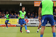 AFC Wimbledon defender Ben Purrington (3) warming up during the EFL Sky Bet League 1 match between AFC Wimbledon and Coventry City at the Cherry Red Records Stadium, Kingston, England on 11 August 2018.