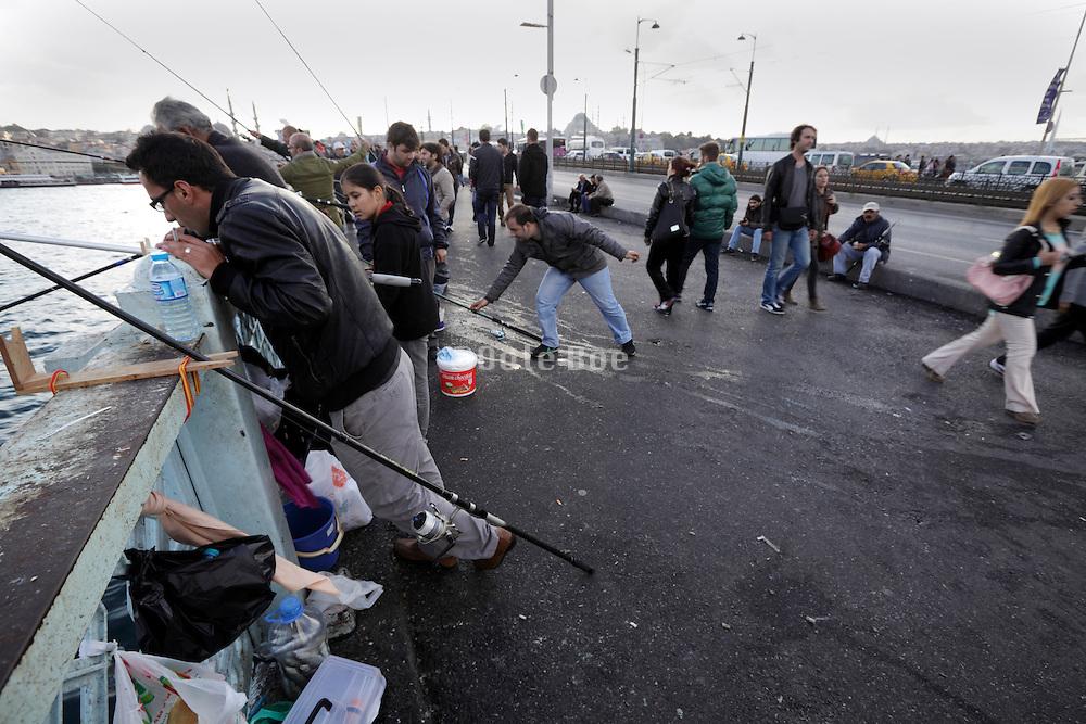 people fishing on the Galata Bridge in Istanbul Turkey