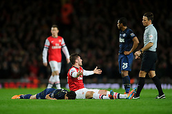 Man Utd Defender Rafael (BRA) lies motionless on the ground after colliding with Arsenal Forward Olivier Giroud (FRA) - Photo mandatory by-line: Rogan Thomson/JMP - 07966 386802 - 12/02/14 - SPORT - FOOTBALL - Emirates Stadium, London - Arsenal v Manchester United - Barclays Premier League.