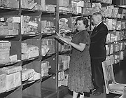 Dorothy Shaul and Leonard Metzger sorted misaddressed packages at the Seattle Post Office in 1950. Did someone mail you a Christmas present which you didn't receive? Chances are it sat among the 1,100 packages Seattle postal workers couldn't deliver. (The Seattle Times)
