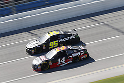 April 29, 2018 - Talladega, Alabama, United States of America - Clint Bowyer (14)  battles side by side down the front stretch for position during the GEICO 500 at Talladega Superspeedway in Talladega, Alabama. (Credit Image: © Justin R. Noe Asp Inc/ASP via ZUMA Wire)