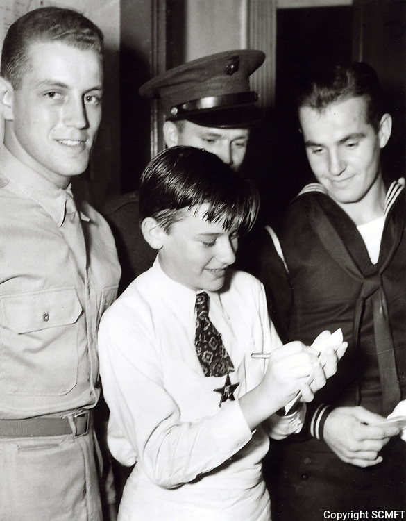 1944 Roddy McDowell signs autographs at the Hollywood Canteen