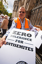 """Royal Courts of Justice, London,  August 31st 2014. Placards are handed out as thousands of Jews and their supporters from London and across the UK demand """"Zero Tolerance for Antisemites"""", organised by the Campaign Against Antisemitism."""
