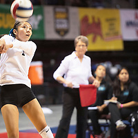 Navajo Prep's Cienna Harrison (1) bump the ball during their match against Santa Fe Prep Thursday morning at the Santa Ana Star Center in the NMAA Class 3A State Volleyball tournament in Rio Rancho.