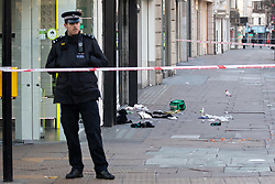 © Licensed to London News Pictures. 17/02/2019. London, UK. The scene on Oxford Street in central London where three men, all aged 24, were stabbed in the early hours of Sunday morning. Police were called just after 3:30am. One man is in a life threatening condition. Two men have been arrested on suspicion of attempted murder. Photo credit : Tom Nicholson/LNP