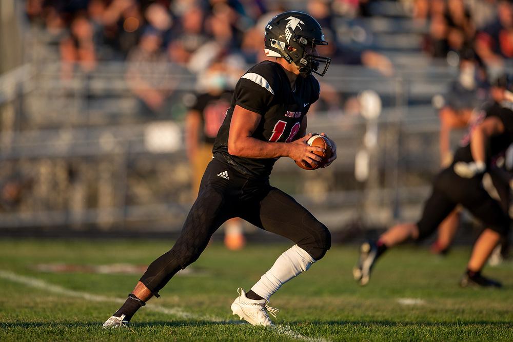 John Glenn's Nathan Creed runs with the ball during the St. Joseph-John Glenn high school football game on Friday, September 4, 2020, at Falcon Field in Walkerton, Indiana.