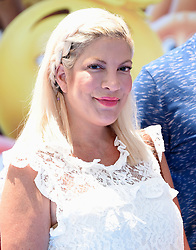 July 23, 2017 - Westwood, California, U.S. - Tori Spelling arrives for the premiere of the film 'The Emoji Movie' at the Regency Village theater. (Credit Image: © Lisa O'Connor via ZUMA Wire)