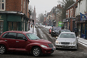 Traffic struggles in freezing weather, dubbed The Beast from the East due to the sub zero cold temperature winds coming in from Siberia, descends on Kings Heath High Street on 1st March 2018 in Birmingham, United Kingdom.