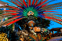 Street performers wearing Mayan costuemes, La Quinta Avenida (5th Avenue), a pedestrian shopping street in Playa del Carmen, Riviera Maya, Quintana Roo, Mexico.