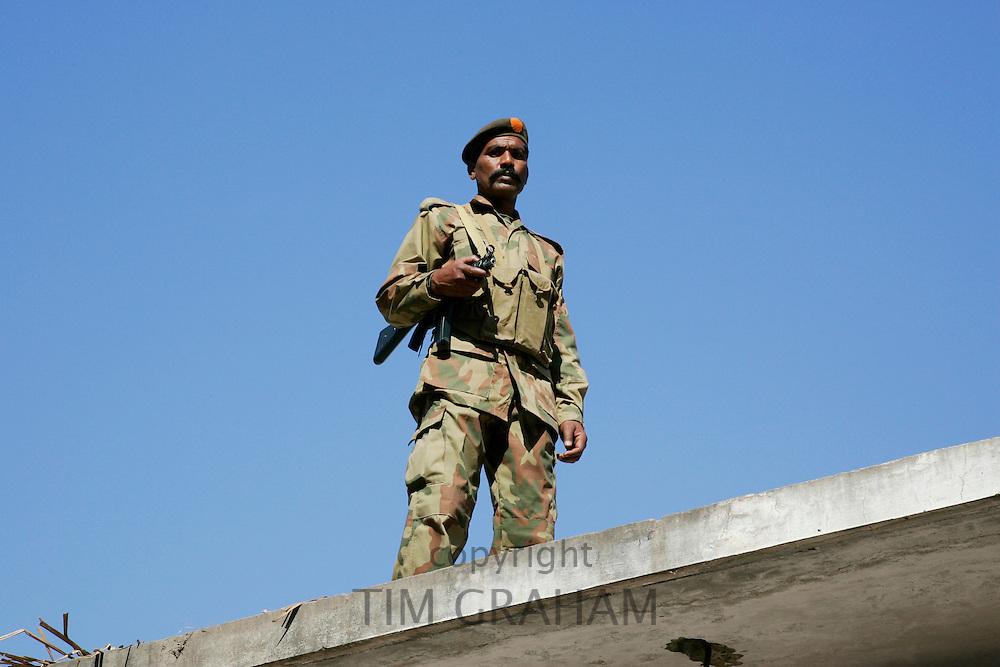 Armed Pakistani soldier on duty in village of Pattika, Pakistan