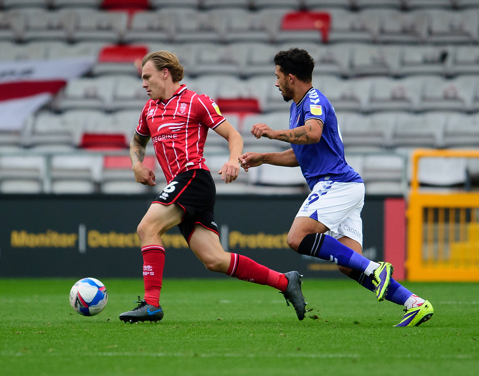 Lincoln City's Harry Anderson vies for possession with Charlton Athletic's Macauley Bonne<br /> <br /> Photographer Andrew Vaughan/CameraSport<br /> <br /> The EFL Sky Bet League One - Lincoln City v Charlton Athletic - Sunday 27th September, 2020 - LNER Stadium - Lincoln<br /> <br /> World Copyright © 2020 CameraSport. All rights reserved. 43 Linden Ave. Countesthorpe. Leicester. England. LE8 5PG - Tel: +44 (0) 116 277 4147 - admin@camerasport.com - www.camerasport.com