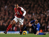 Photo: Javier Garcia/Back Page Images<br />Arsenal v Chelsea, FA Barclays Premiership, Highbury 12/12/04<br />Thierry Henry shrugs off Frank Lampard