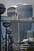 The British Union Jack flag flies from the high-level walkway of the Victorian-era Tower Bridge, near the modern Walkie Talkie building (aka 20 Fenchurch Street), on 14th September 2017, in London, England.