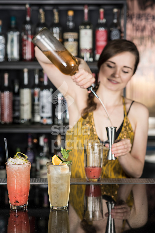 Zoe van der Grinten mixes a Jughead Swizzle rum cocktail at The Curtain, Shoreditch<br /> Picture by Daniel Hambury/Stella Pictures Ltd 07813022858<br /> 24/07/2017
