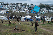 Lesbos, Greece, 3/5/20   An Afghan man is flying a kite on a hill overlooking Moria refugee camp.