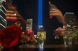 September 12, 2016 - New York, New York, USA - Flowers and flags are seen on the edge of 9/11 Memorial Ponds. 15th anniversary of tragedy 9/11 in New York. (Credit Image: © Anna Sergeeva via ZUMA Wire)