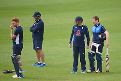 England head coach Trevor Bayliss and captain Eoin Morgan (right) look towards Jonny Bairstow (left) during the nets session at Cardiff Wales Stadium.