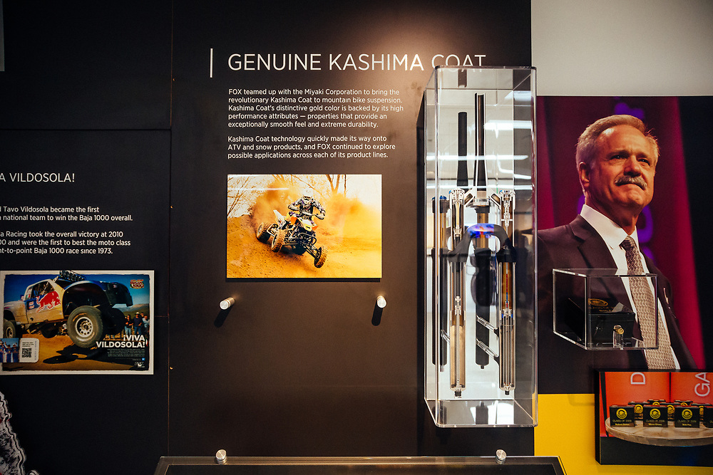 The museum wall history display for the Kashima Coating.