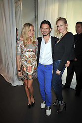 Left to right, SIENNA MILLER, MATTHEW WILLIAMSON and SAVANNAH MILLER at a party to celebrate the launch of the Matthew Williamson collection at H&M held at the H&M store, Regent Street, London on 22nd April 2009.