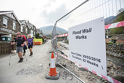 © Licensed to London News Pictures. 11/05/2016. Glenridding UK. Picture taken 10/05/2016 shows Glenridding five months after storm Desmond flooded the village in December. The diggers are still in the village of Glenridding five months after storm Desmond hit the area & flooded the village three times last December. Residents of the village have become frustrated at the Environment Agency after it took almost four months for the agency to start work on new flood defences leaving the village looking like a building site during the normally busy tourist period essential to get the area back on it's feet. Photo credit: Andrew McCaren/LNP