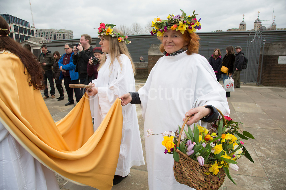 The Lady and Her Two Maids during The Druid Order Spring Equinox ceremony held at Tower Hill Terrace in London, England, United Kingdom. The druids hold a ceremony celebrating the rise of the light. Ceridwen, the earth mother, brings token seeds which are symbolically sown around a circle. The concern of The Druid Order is with the evolution of humanity in harmony with the universe and to teach through open meetings, ceremonies, meditation and ritual.