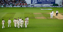© Licensed to London News Pictures. 25/08/2013. London, UK Investec 5th Ashes Test, The Kia Oval, 5th day, 25/08/2013 Australia leave the pitch due to poor light to end the 5th test. Photo credit : Mike King/LNP
