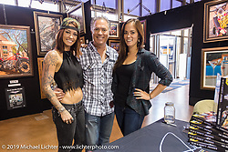 Scott Jacobs with daughter's Alexis (L) and Olivia (R) in their display at Black Hills Harley-Davidson dealership during the annual Sturgis Black Hills Motorcycle Rally. SD, USA. August 5, 2014.  Photography ©2014 Michael Lichter.