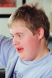Portrait of teenage boy with Downs Syndrome,