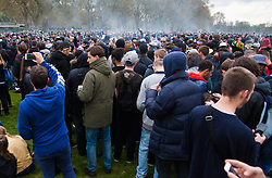 Hyde Park, London, April 19th 2015. Hundreds of cannabis users and their supporters gather at Speaker's Corner in Hyde Park for the annual London 420 pro-cannabis rally, under the watcful eye of Metropolitan Police officers, who kept a reasonably low profile, allowing the rally to continue without any serious incidents. PICTURED: A cloud of cannabis smoke rises from the crowd as the rally draws to its conclusion.