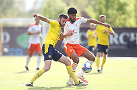 Oxford United's Elliott Moore and Blackpool's Ellis Simms<br /> <br /> Photographer Rob Newell/CameraSport<br /> <br /> Sky Bet League One Play-Off Semi-Final 1st Leg - Oxford United v Blackpool - Tuesday 18th May 2021 - Kassam Stadium - Oxford<br /> <br /> World Copyright © 2021 CameraSport. All rights reserved. 43 Linden Ave. Countesthorpe. Leicester. England. LE8 5PG - Tel: +44 (0) 116 277 4147 - admin@camerasport.com - www.camerasport.com