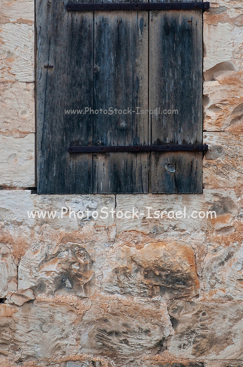 Close up of an old unkempt stone wall of an old templer building in Beit Lehem Haglilit, Israel. Bethlehem of the Galilee is a small community located in the western Galilee (northern Israel) was founded by the Haifa Templers in 1906