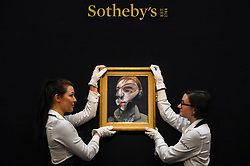 "© Licensed to London News Pictures. 21/06/2019. LONDON, UK. Technicians present ""Self-Portrait"", 1975, by Francis Bacon (Est. GBP 15-20m) at the preview of a Contemporary Art auction at Sotheby's New Bond Street.  The sales take place 26 and 27 June 2019.  Photo credit: Stephen Chung/LNP"
