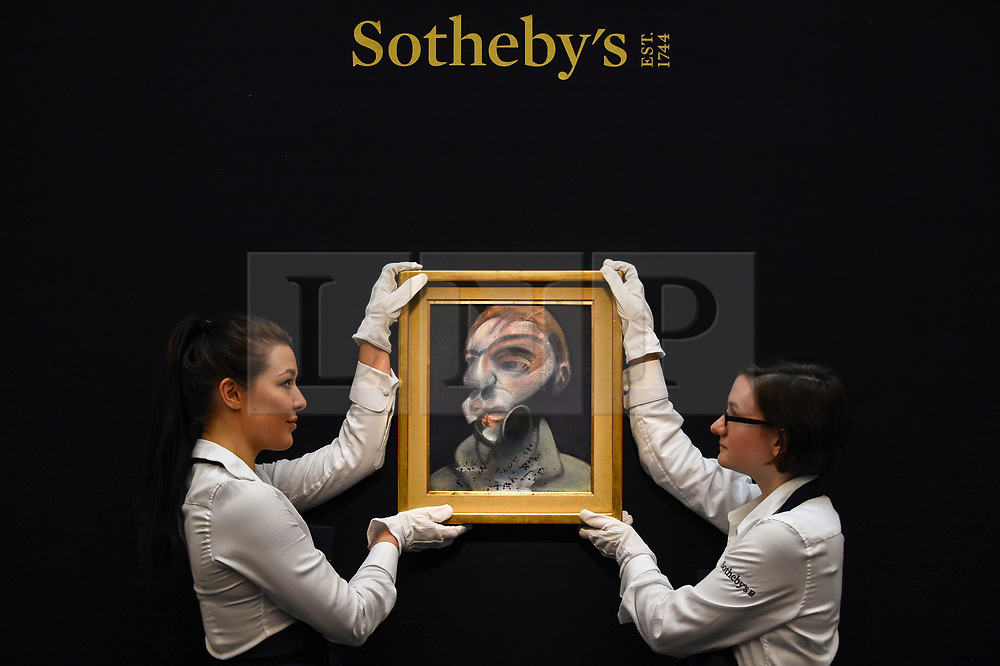 """© Licensed to London News Pictures. 21/06/2019. LONDON, UK. Technicians present """"Self-Portrait"""", 1975, by Francis Bacon (Est. GBP 15-20m) at the preview of a Contemporary Art auction at Sotheby's New Bond Street.  The sales take place 26 and 27 June 2019.  Photo credit: Stephen Chung/LNP"""