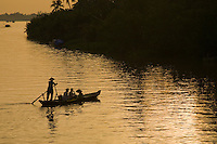 Mekong River Sunset - The Mekong River is one of the world's longest rivers running from Tibet through Yunnan China, Burma, Thailand, Laos and lastly Vietnam.  It is a lifeline of transportation, food and recreation.