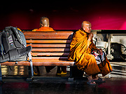 02 JANUARY 2019 - BANGKOK, THAILAND:      Buddhist monks wait for their train in Hua Lamphong Train Station in Bangkok. The train and bus stations in Bangkok were crowded Wednesday with people going home after the long New Year's weekend.    PHOTO BY JACK KURTZ